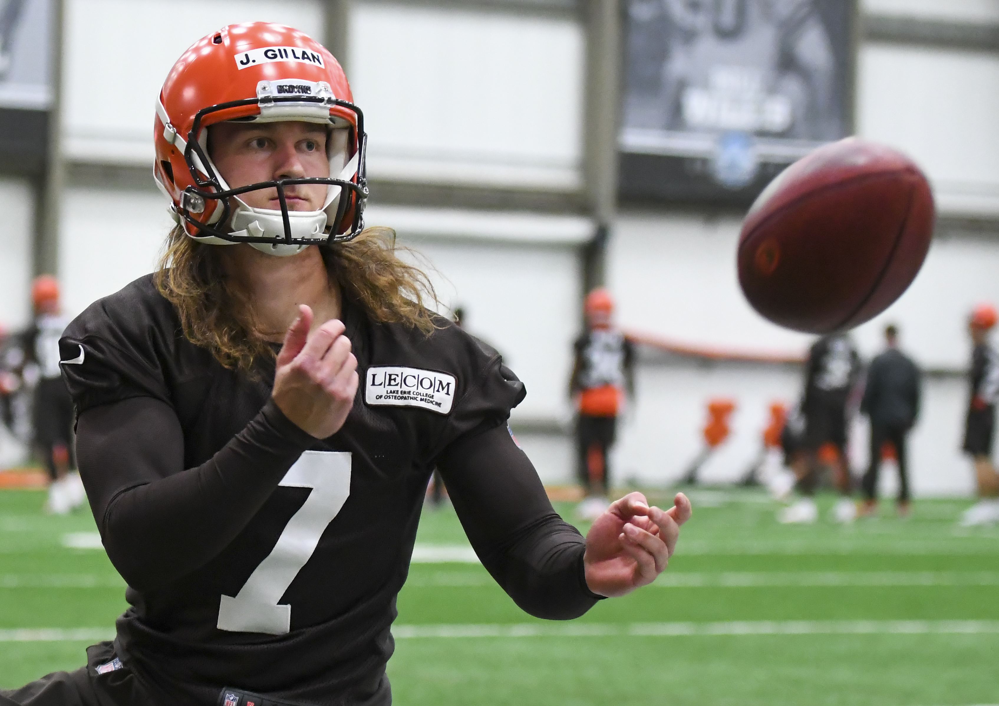 Punter Jamie Gillan #7 of the Cleveland Browns warms up on the sideline during a rookie mini camp. (Photo by: 2019 Diamond Images/Getty Images)
