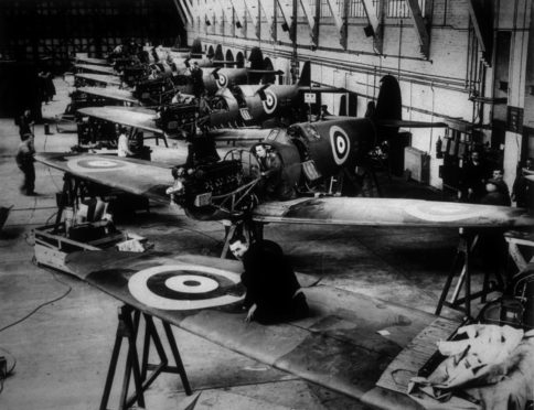 circa 1940:  The Spitfire production line at the Vickers Supermarine Works in Southampton.  (Photo by Keystone/Getty Images)