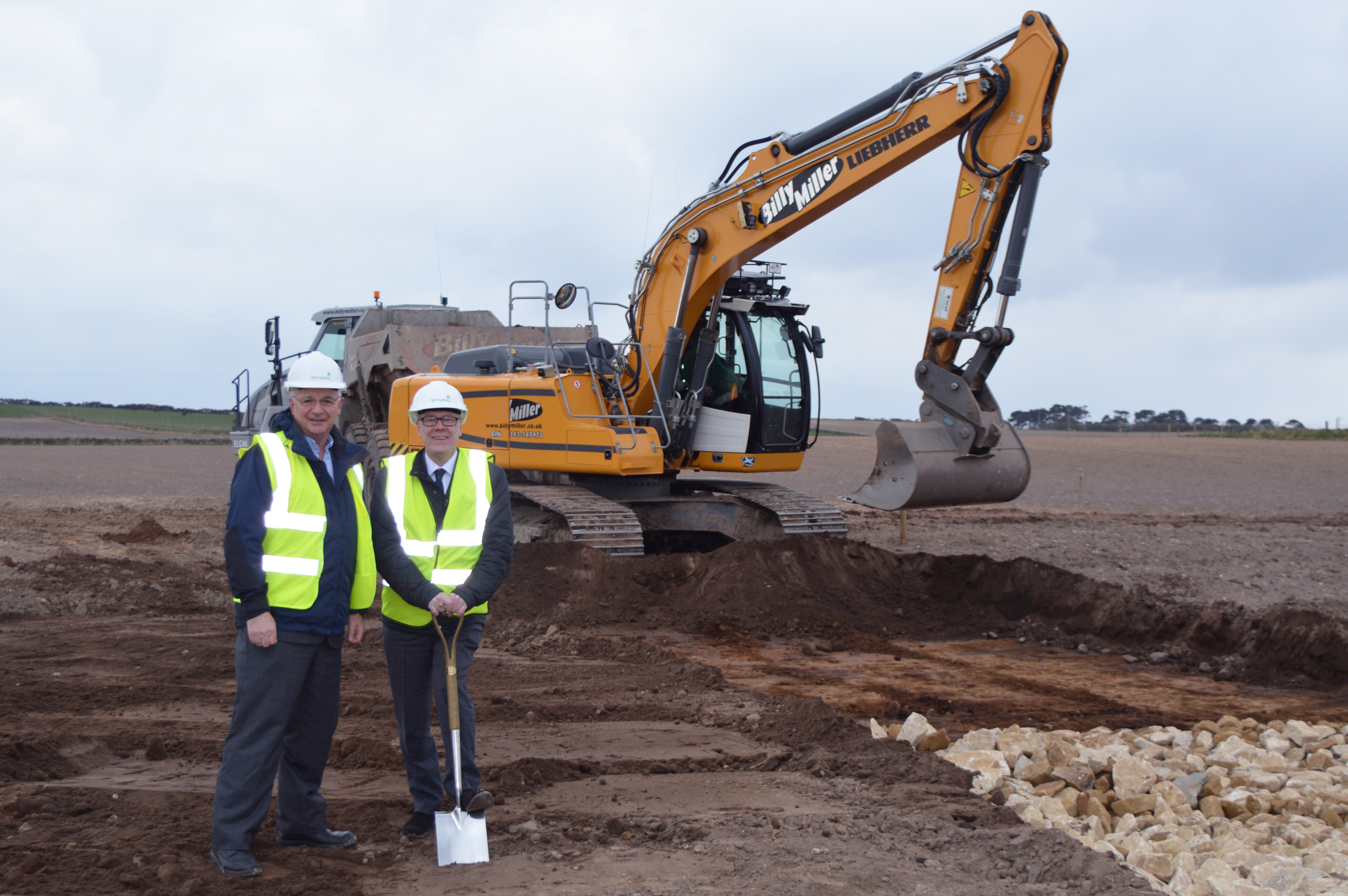 Springfield chairman Sandy Adam with Scottish Government Housing Minister Kevin Stewart.