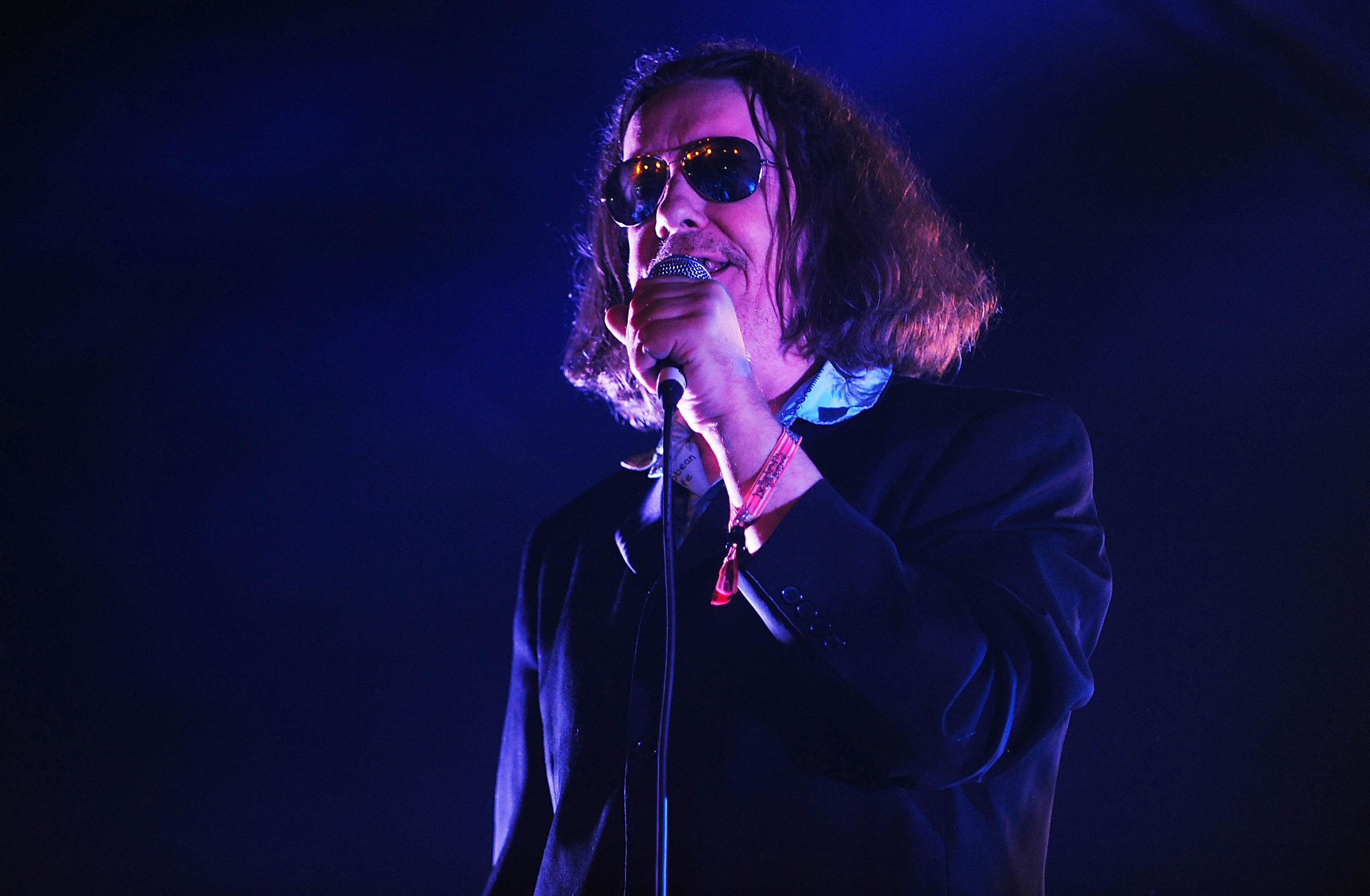 Jake Black perfoming with The Alabama 3 in Belladrum in 2013.