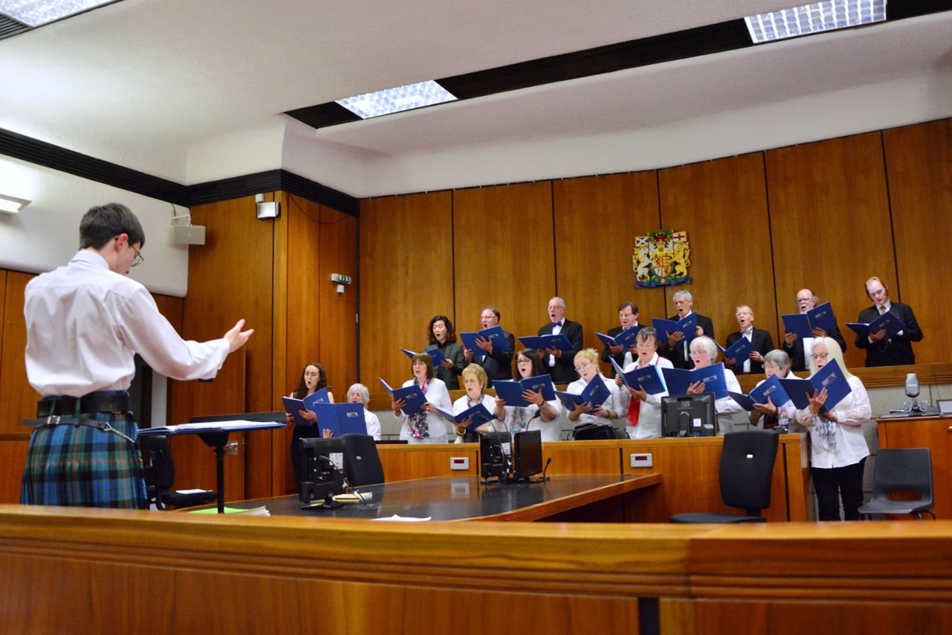 James Campbell directing the singers of Ugie Voices in Peterhead Sheriff Court