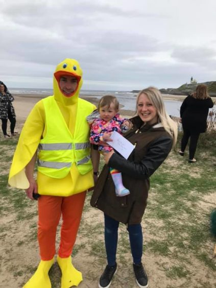 Lisa-Marie Gray with her daughter Lily and Alex Irvine dressed as Deveron Duck