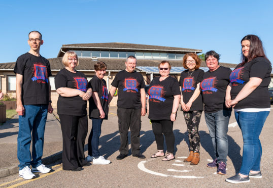 Committee members of MBVS outside the Moray Resource Centre. Pictured: Scott More, Helen Chalmers, Robina McKnockiter, Tommy Chalmers, Heather Richardson, Muriel Paton, Elizabeth Davidson and Chloe Cameron.