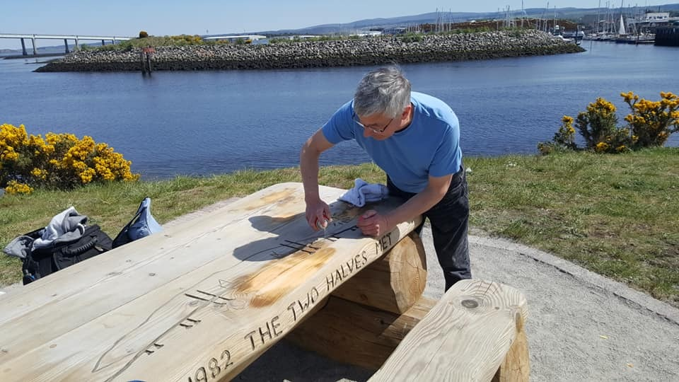 Andrew Zeglicki sanding down the damaged picnic bench at Carnac Point, South Kessock.