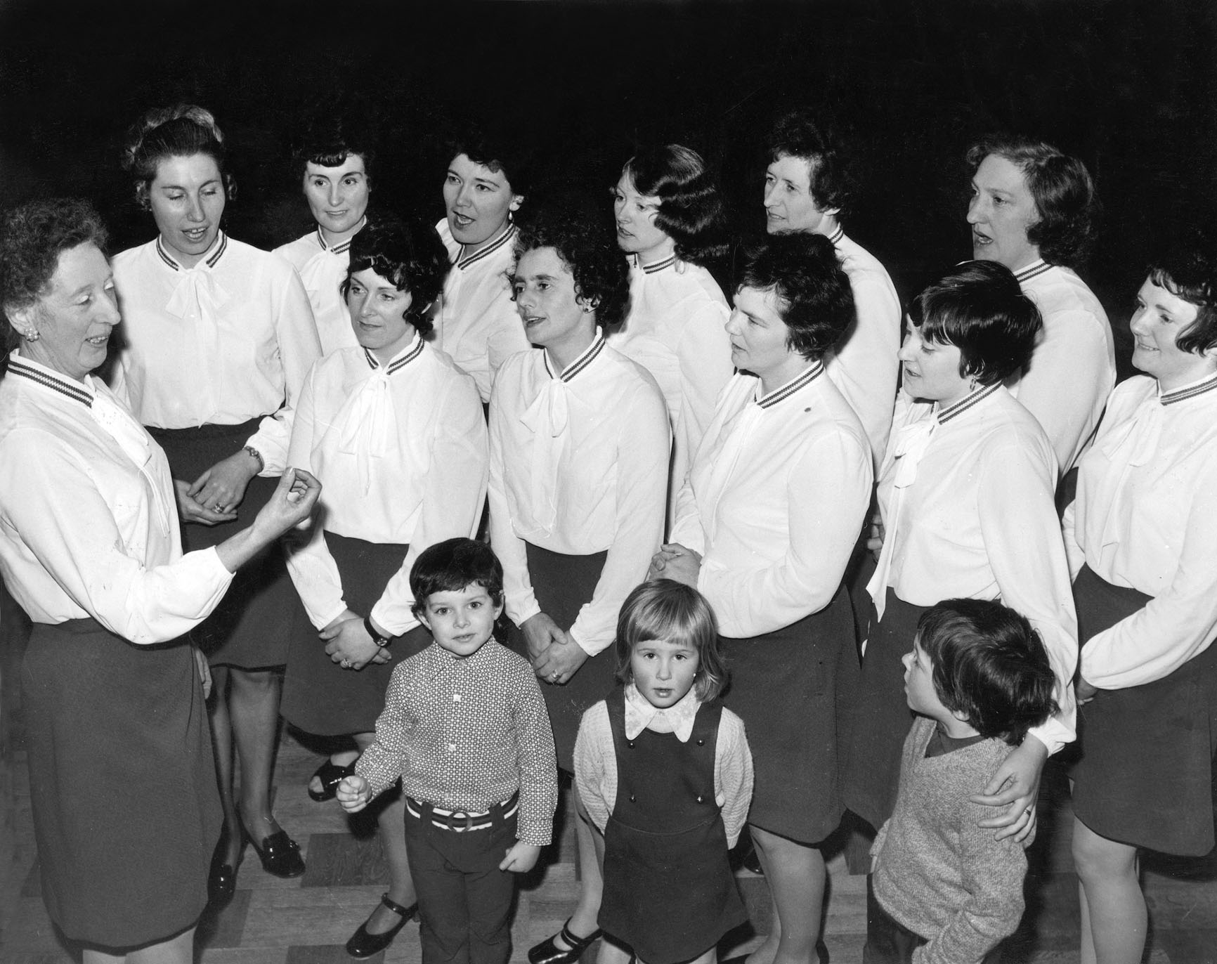 ON SONG: Mrs Netta Thom conducts the Young Wives' Group Choir of Kincorth South St Nicholas Church, Aberdeen, at a rehearsal in March 1973.