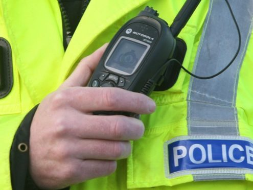 Two men have been charged after a Moray bar was broken into