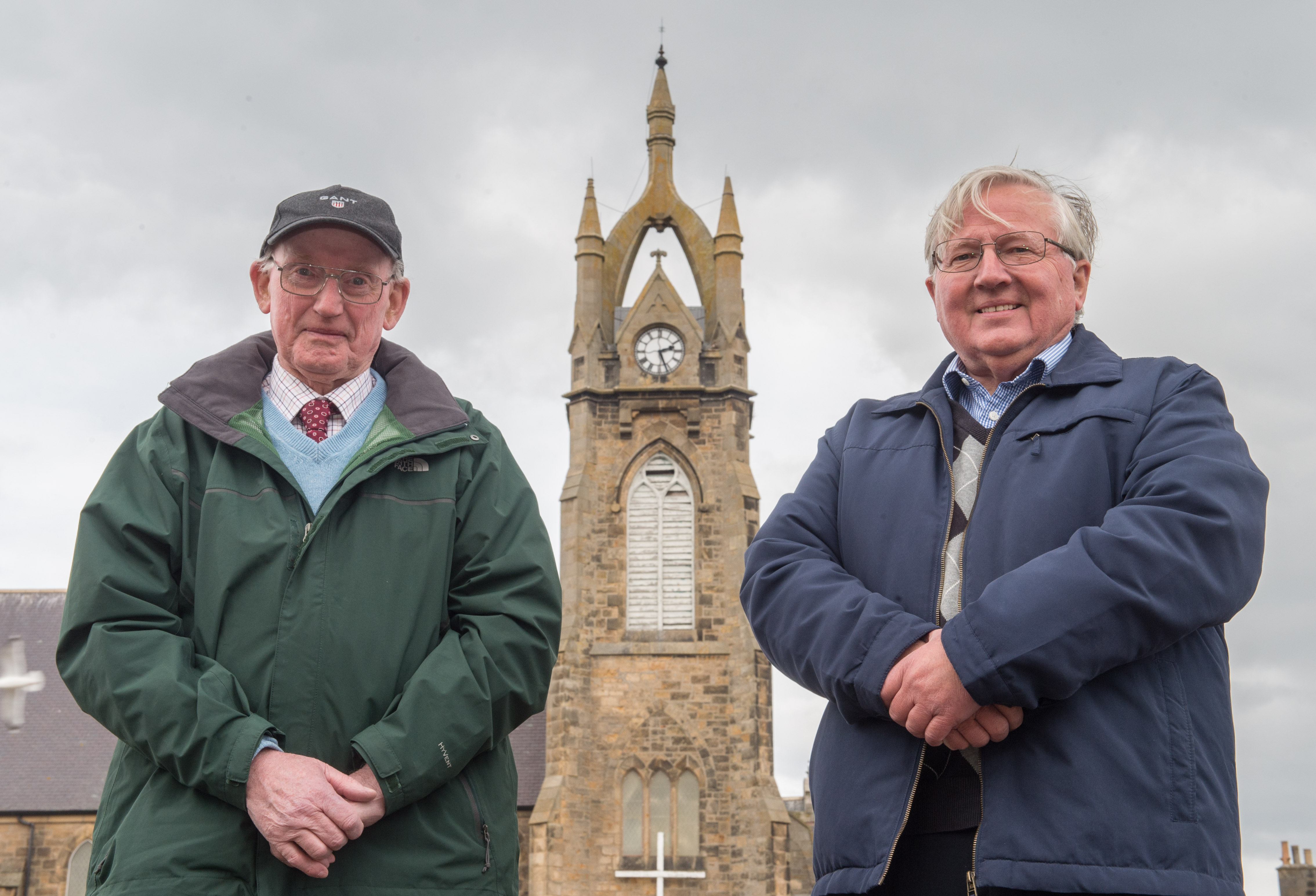 Ian Moir and Iain G Woods with the clock in Buckie.  Picture by Jason Hedges