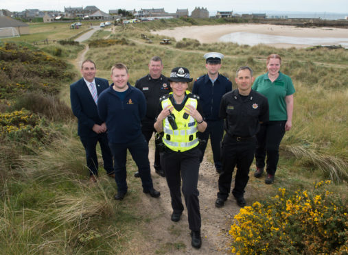 Picture: L2R - Cllr James Allan, Colin Wood (Senior Coastal Operation Officer - HM Coastguard), Ewen McIntosh (Rural Watch Manager)  Kerry Rigg (Local Policing Inspector),  RAF Police Cpl Jamie Barstow, Gareth Luce (Watch Manager) and Fiona Robertson (Forestry and Land Scotland). Picture by Jason Hedges.