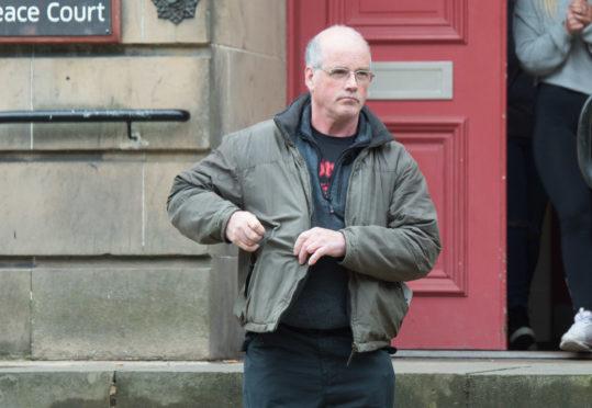 Robert McHardy leaving Elgin Sheriff Court.
