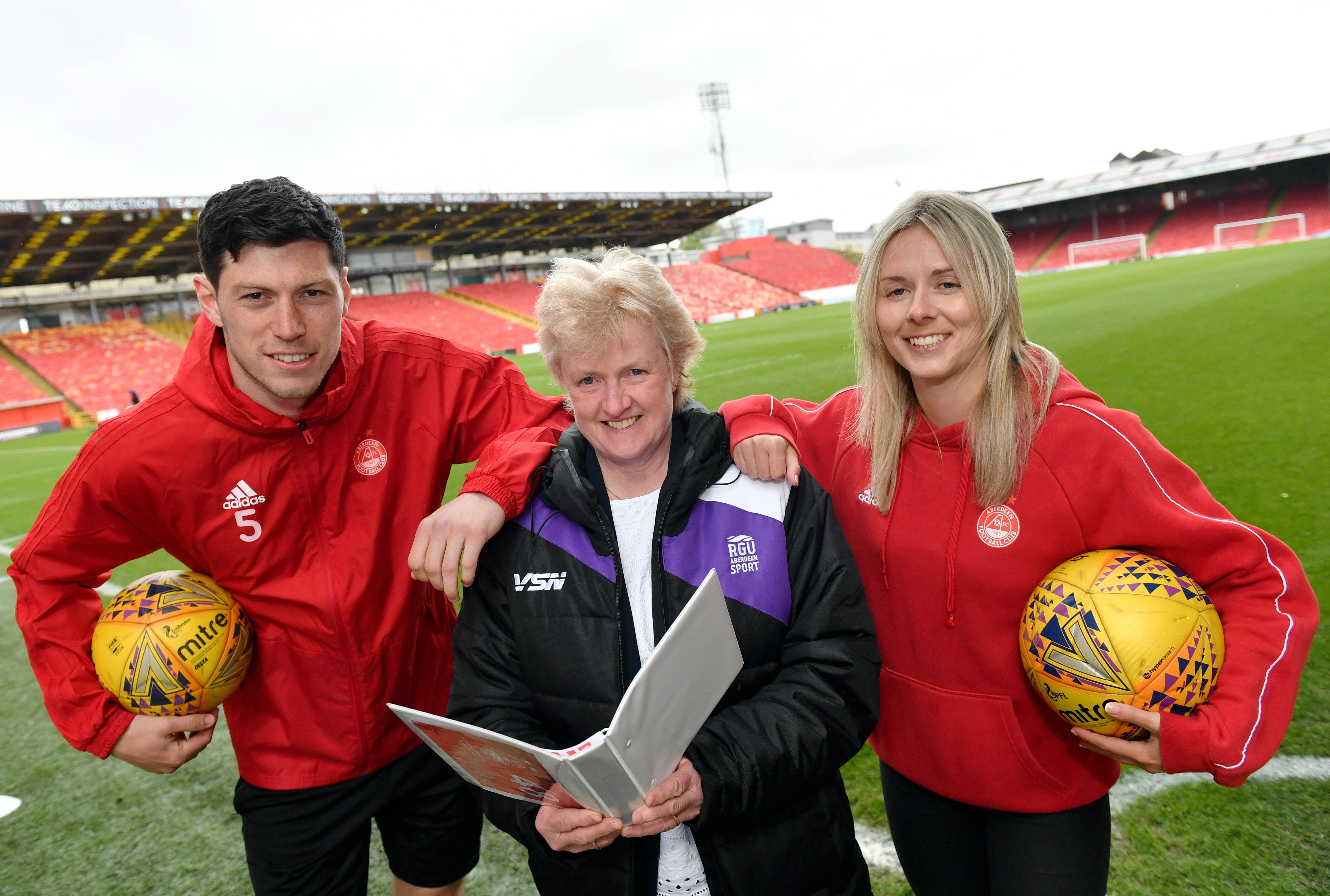 Pictured - L-R Scott McKenna (player), Prof Elizabeth Hancock (RGU) and Loren Campbell (player).      Picture by Kami Thomson