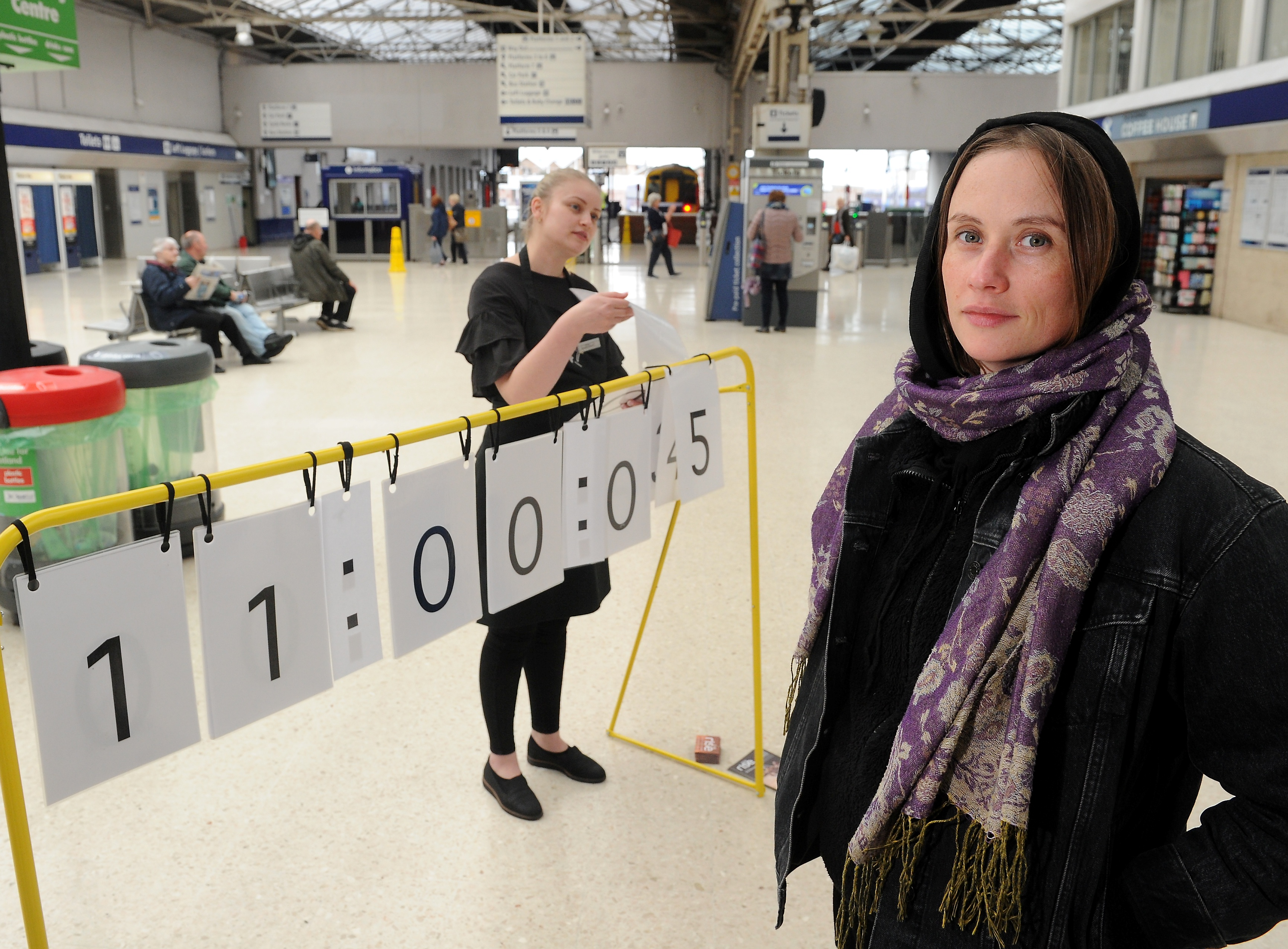 Artist Janine Harrington and member of the public Alexandra Cristache try to keep time with the human powered digital clock on display in Inverness Railway Station yesterday. Picture by Sandy McCook.