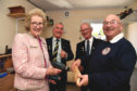 BANFFSHIRE LORD LIEUTENANT CLARE RUSSELL VISITS THE WOODWORKING SECTION AFTER OPENING THE MENS SHED AND PROVED SHE KNOWS THE DRILL TO SECRETARY JIM PATERSON WATCHED BY VICE CHAIRMAN DOD CHRISTIE (L) AND CHAIRMAN KENNY CHRISTIE.
