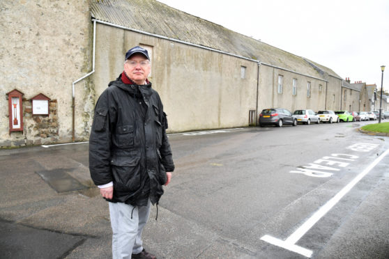 CLLR GLEN REYNOLDS AT BATTERY GREEN BANFF WHERE KEEP CLEAR SIGNS HAVE NOW BEEN PAINTED ON THE ROAD TO ENSURE THERE IS NO OBSTRUCTION TO EMERGENCY SERVICES ACCESSING THE COASTGUARD STATION.