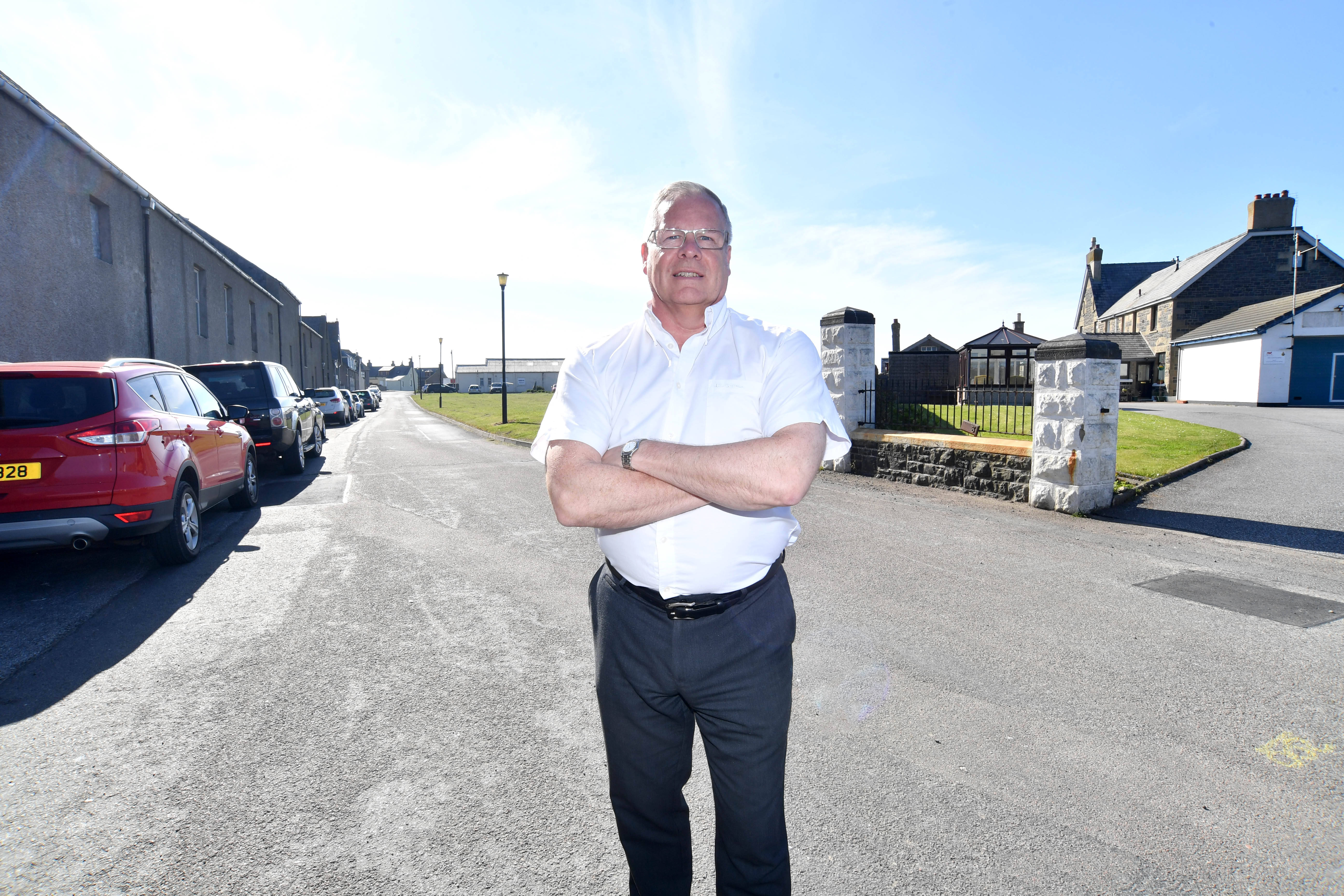 Councillor john cox outside the coastguard station at Battery Green, Banff where parking has been causing problems for emergency services.