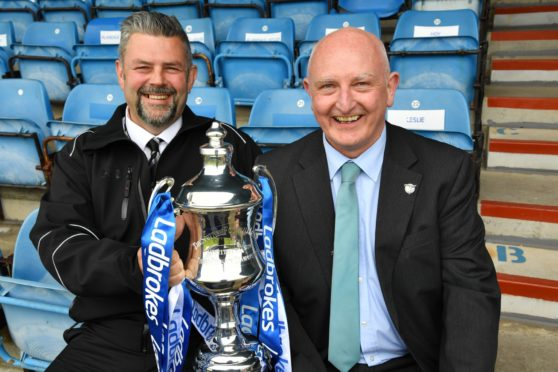 PETERHEAD FC CHIEF EXECUTIVE MARTIN JOHNSTON (R) AND CONRAD RITCHIE FROM SCORE WITH THE LEAGUE 2 TROPHY.