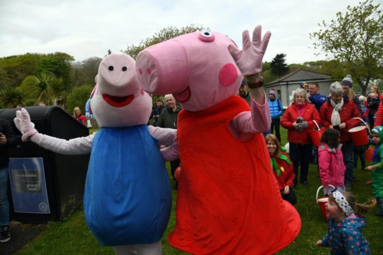 More than 100 enthusiastic Peppa Pig fans were taken on an adventure through the streets of Stornoway to aid the Save the Children charity.