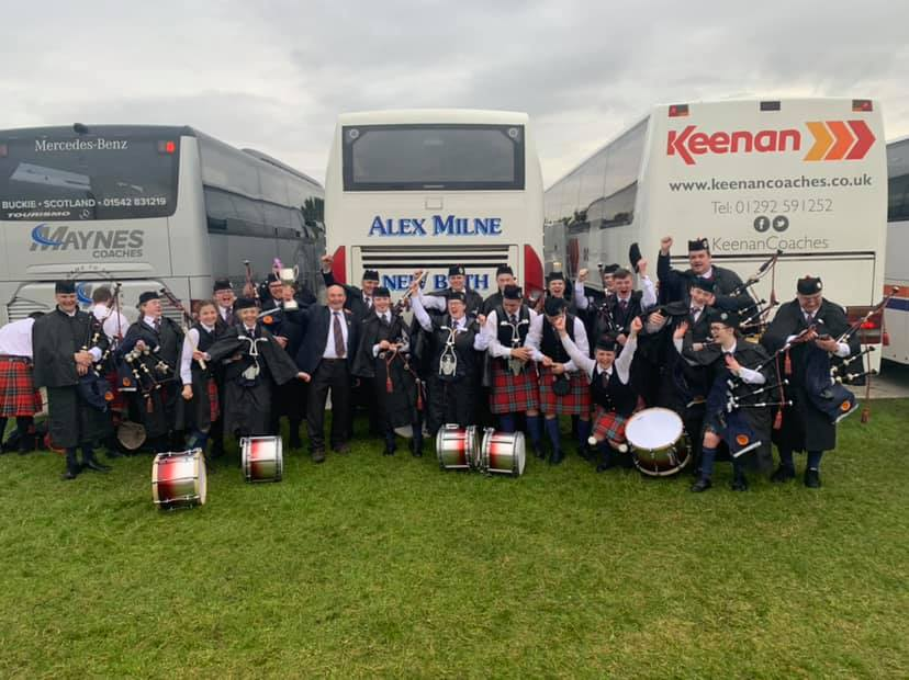 Members of the Turriff and district pipe band celebrate their success