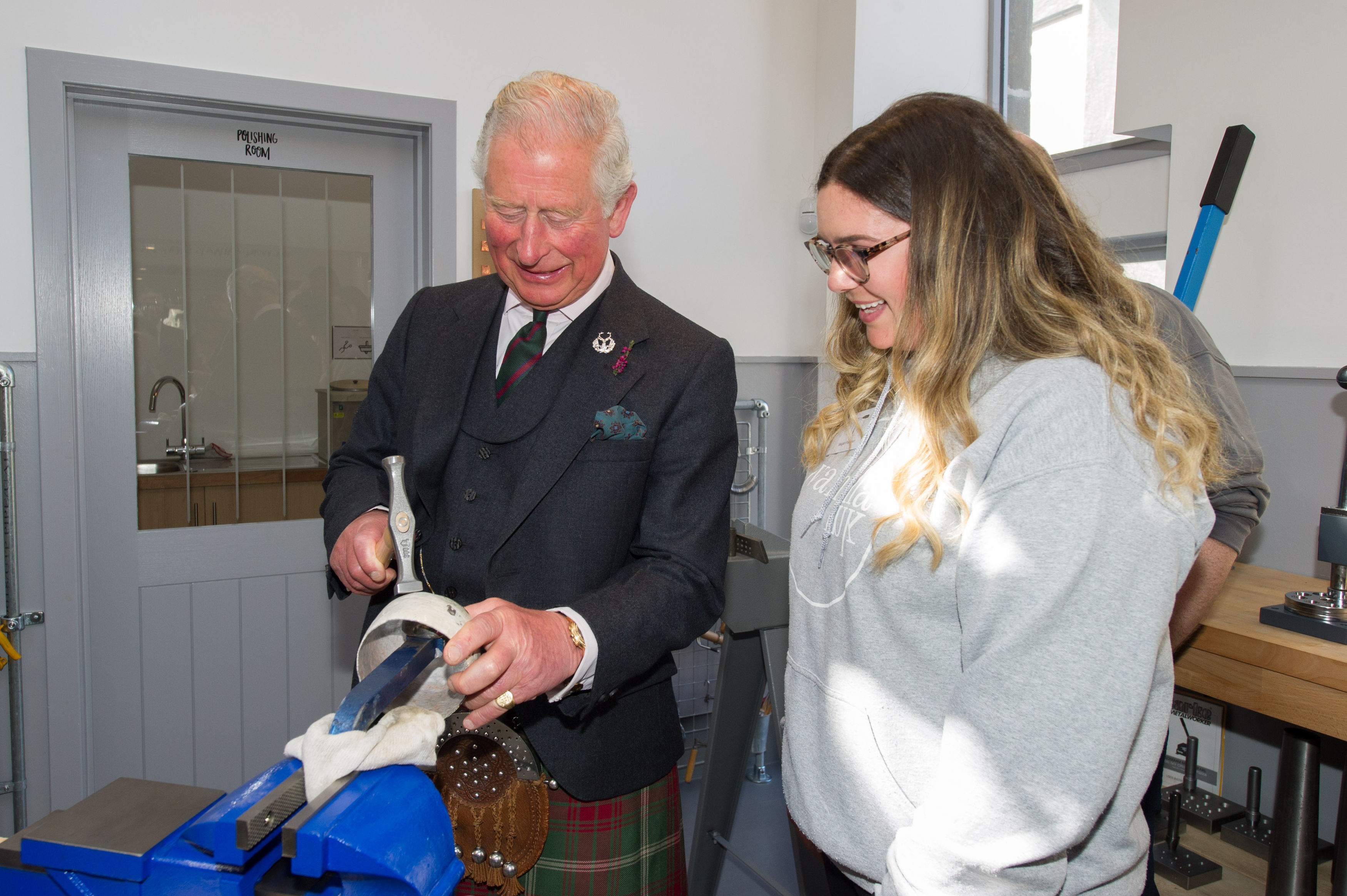 The Prince of Wales, known as the Duke of Rothesay while in Scotland, during a visit to Vanilla Ink in Banff, a Social Enterprise business that is bringing Silversmithing and Jewellery Making skills development opportunities to communities in Scotland. Photo: Jason Hedges/Press and Journal/PA Wire