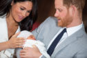 The Duke and Duchess of Sussex with their baby son, who was born on Monday morning