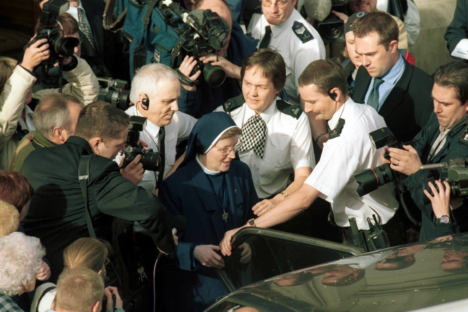 Sister Alphonso is mobbed by press as she leaves Aberdeen sheriff court