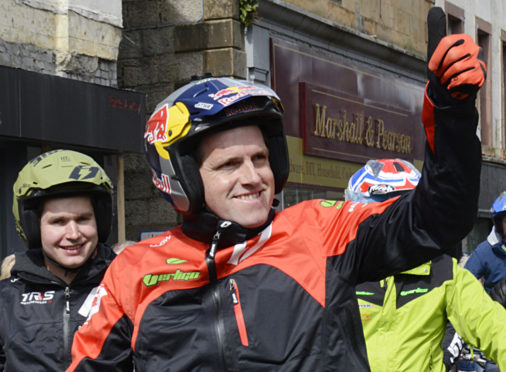 Current champion and 2019 favourite, Dougie Lampkin gives a thumbs up to cheering fans. Picture: Iain Ferguson, The Write Image.