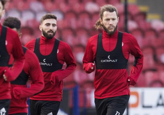 Aberdeen captain Graeme Shinnie (left) and Stevie May.