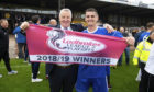 Cove co-manager John Sheran (L) with Daniel Park as they celebrate promotion to Ladbrokes League 2