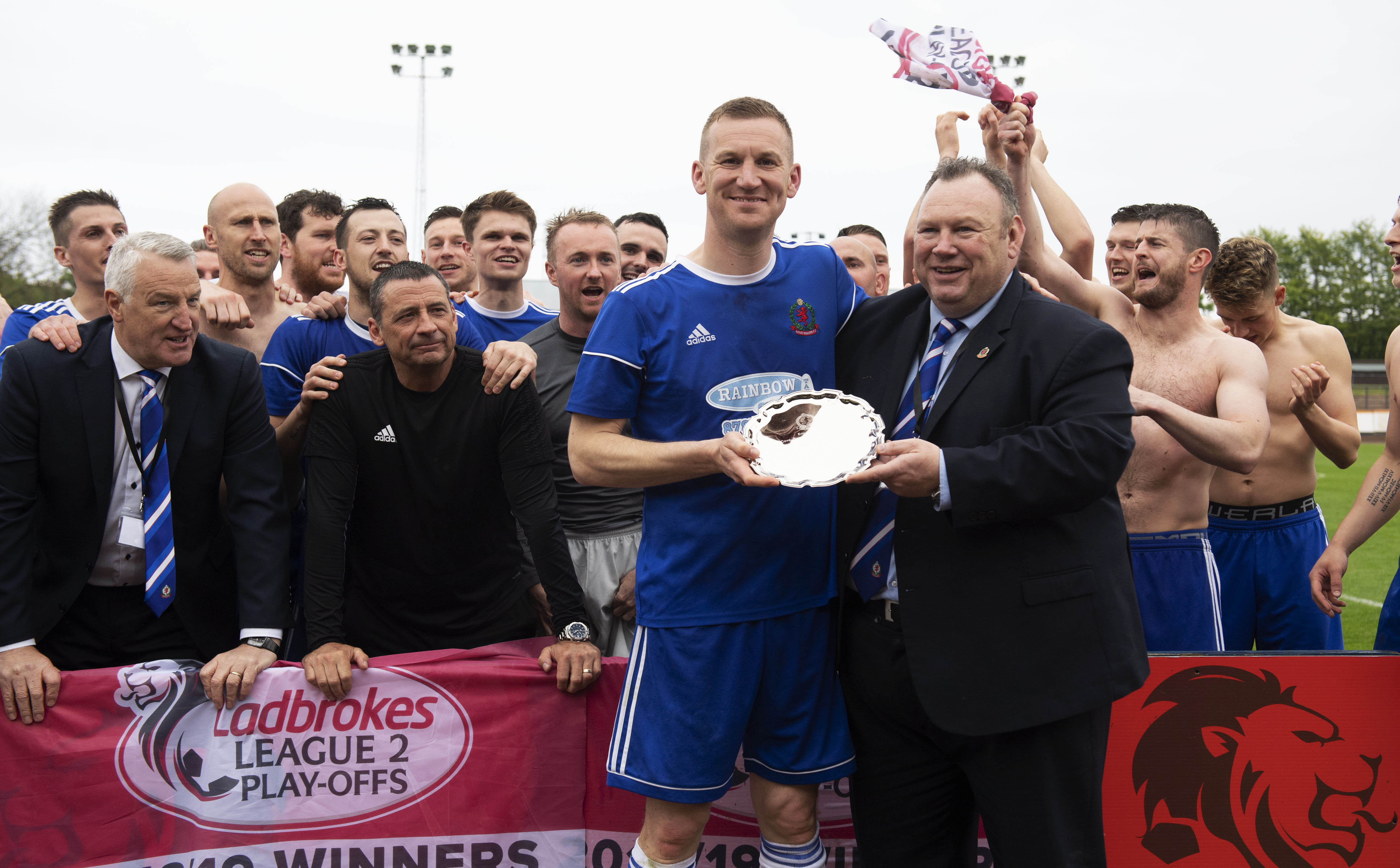 Cove Rangers chairman Keith Moorhouse presents Eric Watson with a commemorative shield on his final appearance for the club, after Cove had secured promotion to League Two.