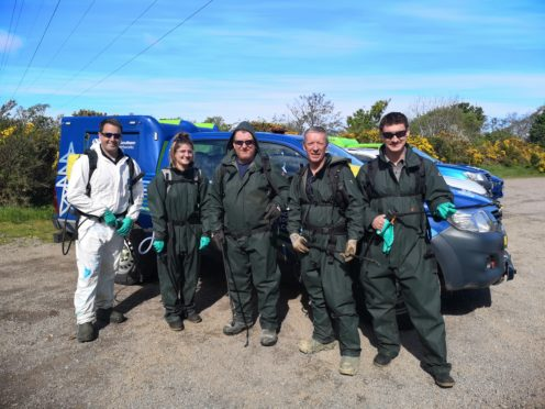 The crew from SSEN Transmission get ready to tackle the hogweed. Pictured: Michael Forrest,  Saffron Cruikshank, Iain Mackintosh, Mike Cowie and Dan Thomas.