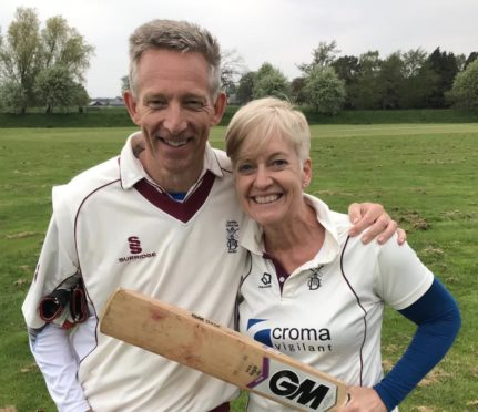 Sue Strachan, with husband Dave, has become the first-ever female president of Cricket Scotland.