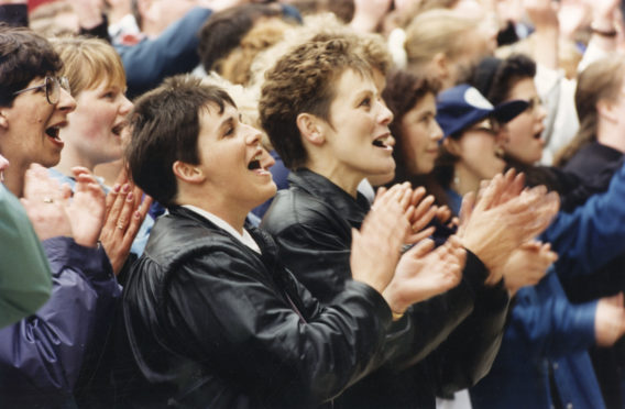 Singing in the rain... Fans join in as Runrig belt out one of their numbers.