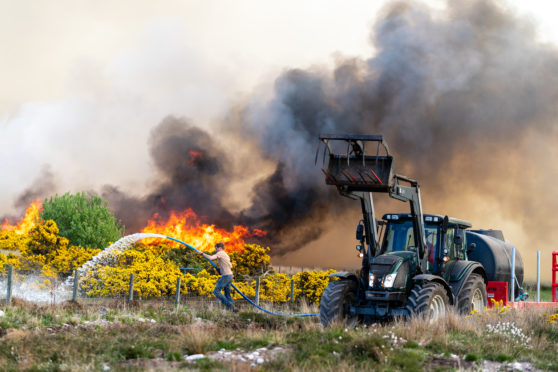 Raging wildfire burning Forrest, Heath, Heather in the very dry area of Dunphail near Forres.
