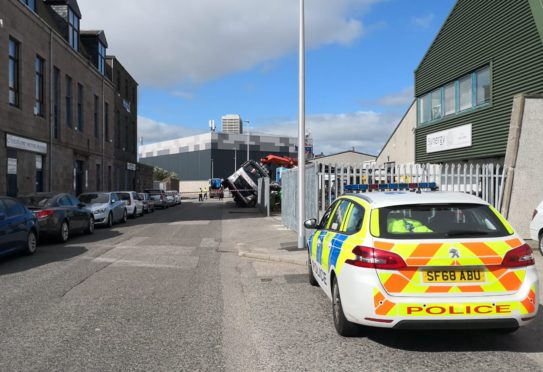 Police on site of the incident on Cotton Street in Aberdeen.