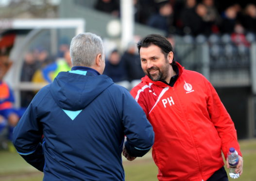 Paul Hartley and John Sheran shake hands ahead of Cove Rangers' Scottish Cup tie with Falkirk in 2018.