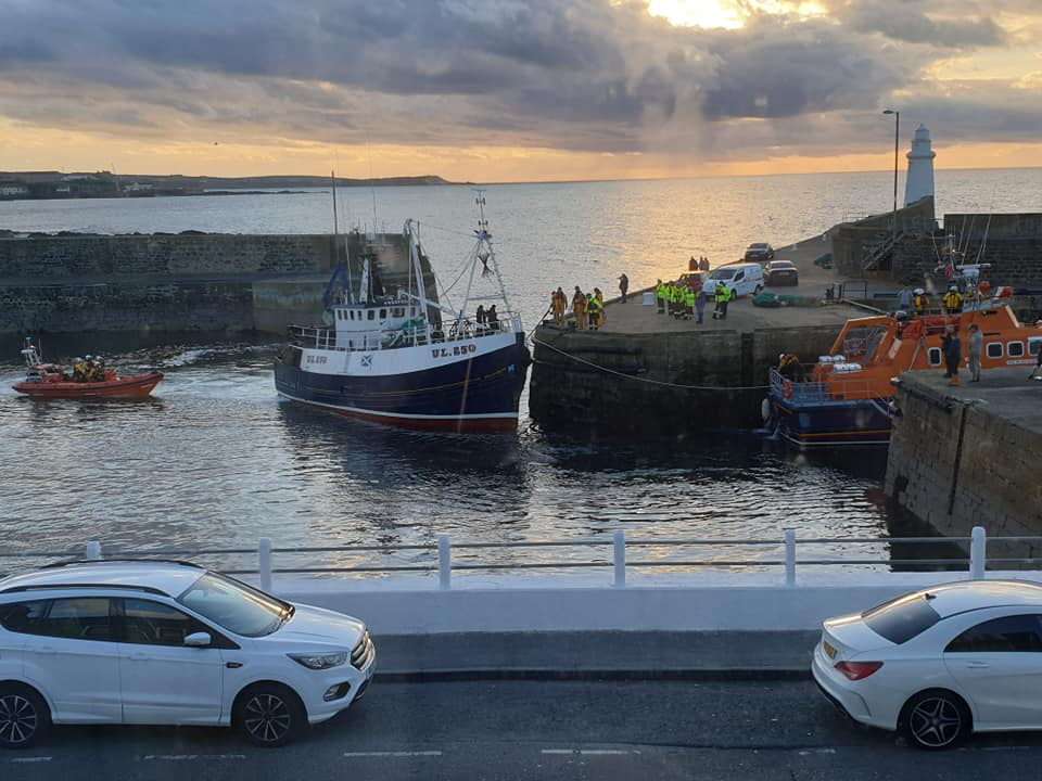 The lifeboat bringing the stricken trawler into Macduff Harbour. Picture taken by Kate Underdown