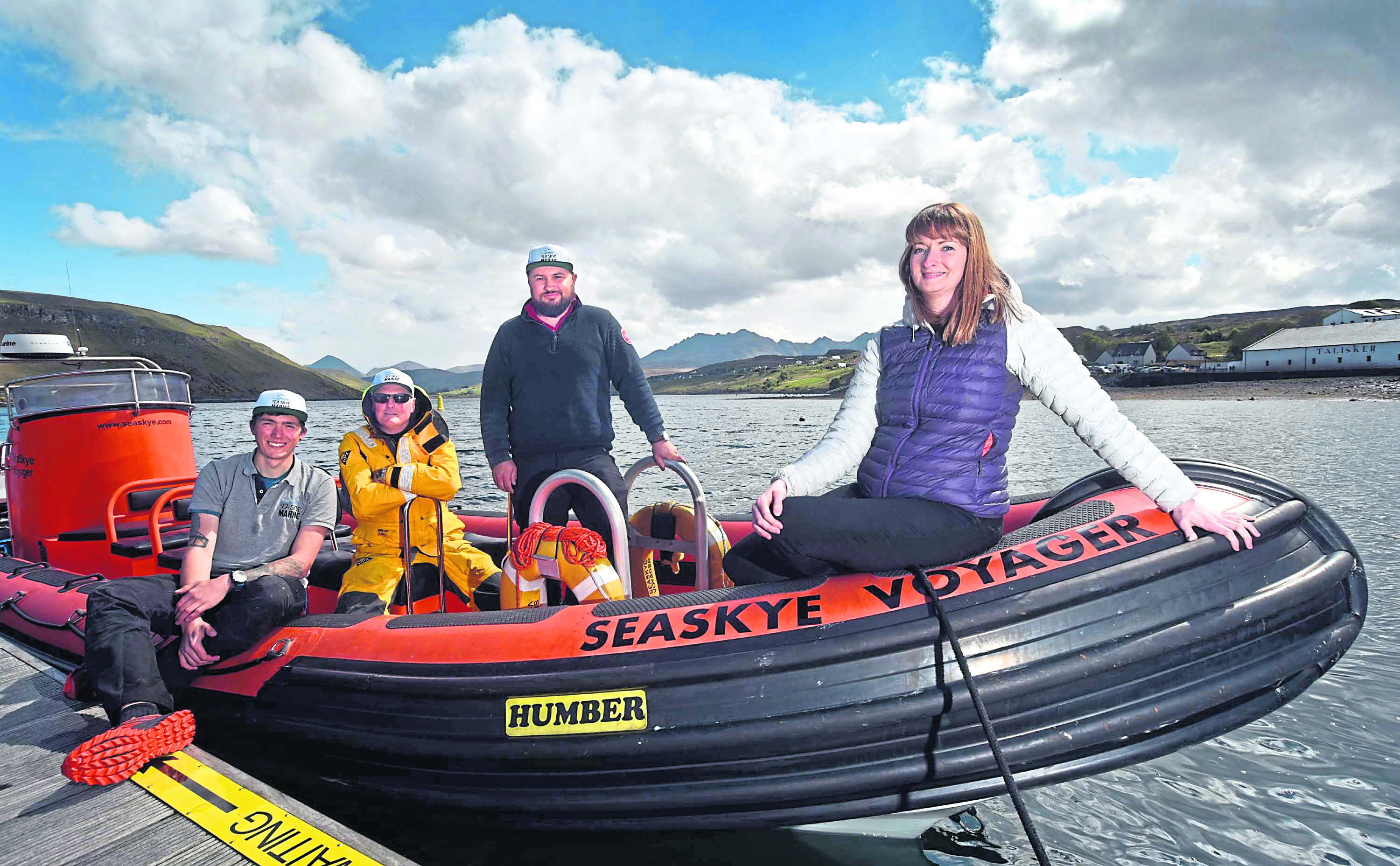 Seaskye's 11-metre vessel (pictured) will be upgraded to a 13- metre vessel, with HIE support. L-R: Jordan Young, Mark Coombe and Kenny MacKinnon of Seaskye Marine, with Eilidh Ross of HIE. Picture by Iain Smith/HIE.