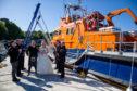 Tobermory lifeboat crew guard of honour for coxswain David and Seonaid