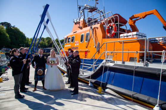 Tobermory lifeboat crew guard of honour for coxswain David and Seonaid