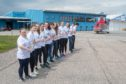 Youngsters from Robert Gordon's College worked together to pill an 8.6 tonne helicopter on Sunday.