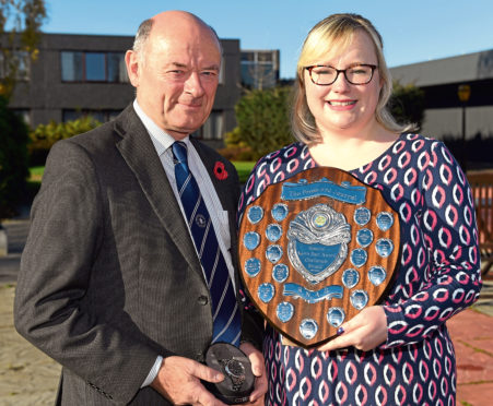 Press and Journal farming editor Gemma Mackenzie presenting an award to Graham Bruce last year.