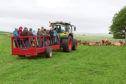Despite the damp weather farm tours ran throught the day at Highland Sheep.