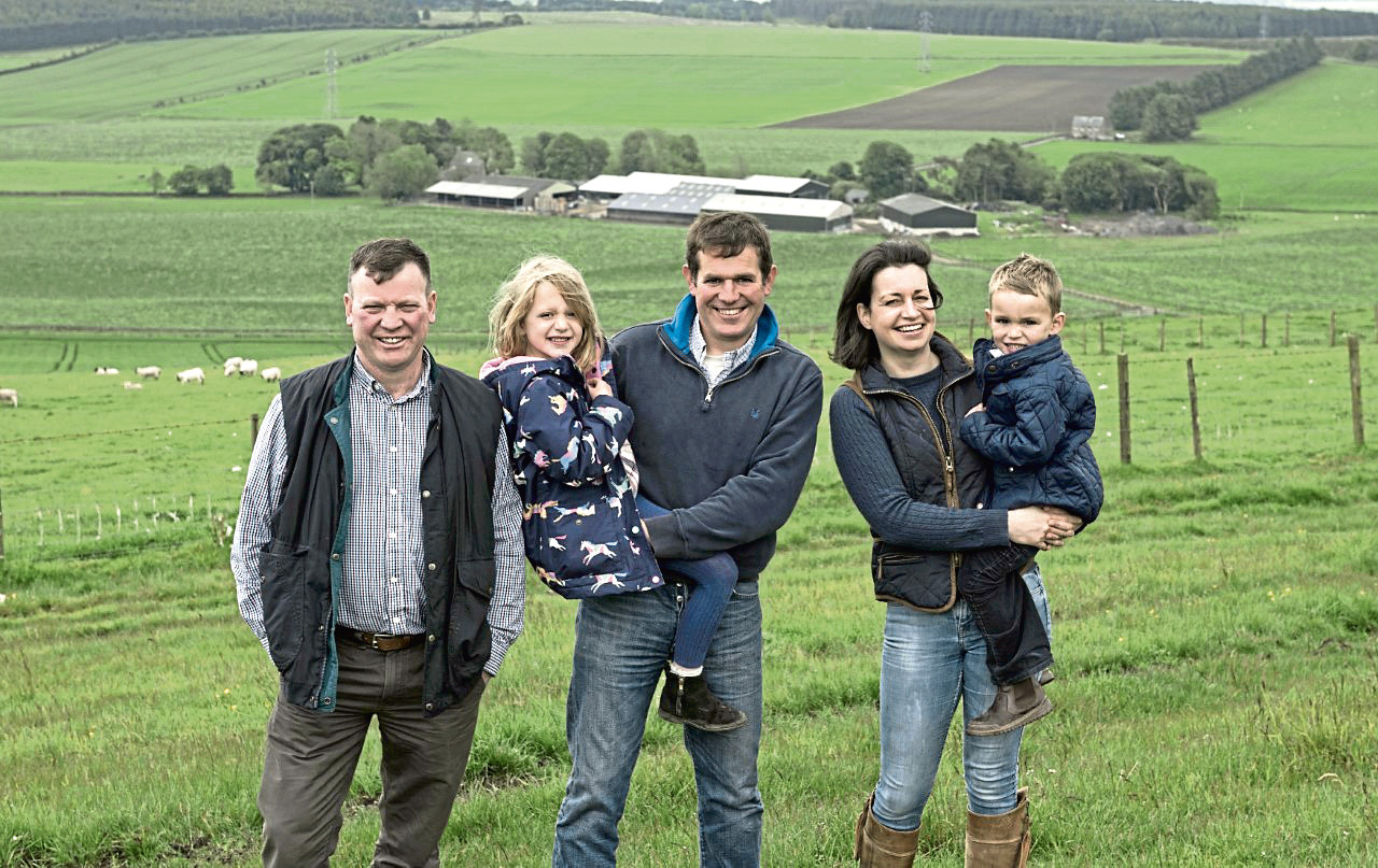 From left, NSA Scotsheep event chairman Willy Millar, with host farmers, Robert and Hazel McNee and children, Kate and Alan