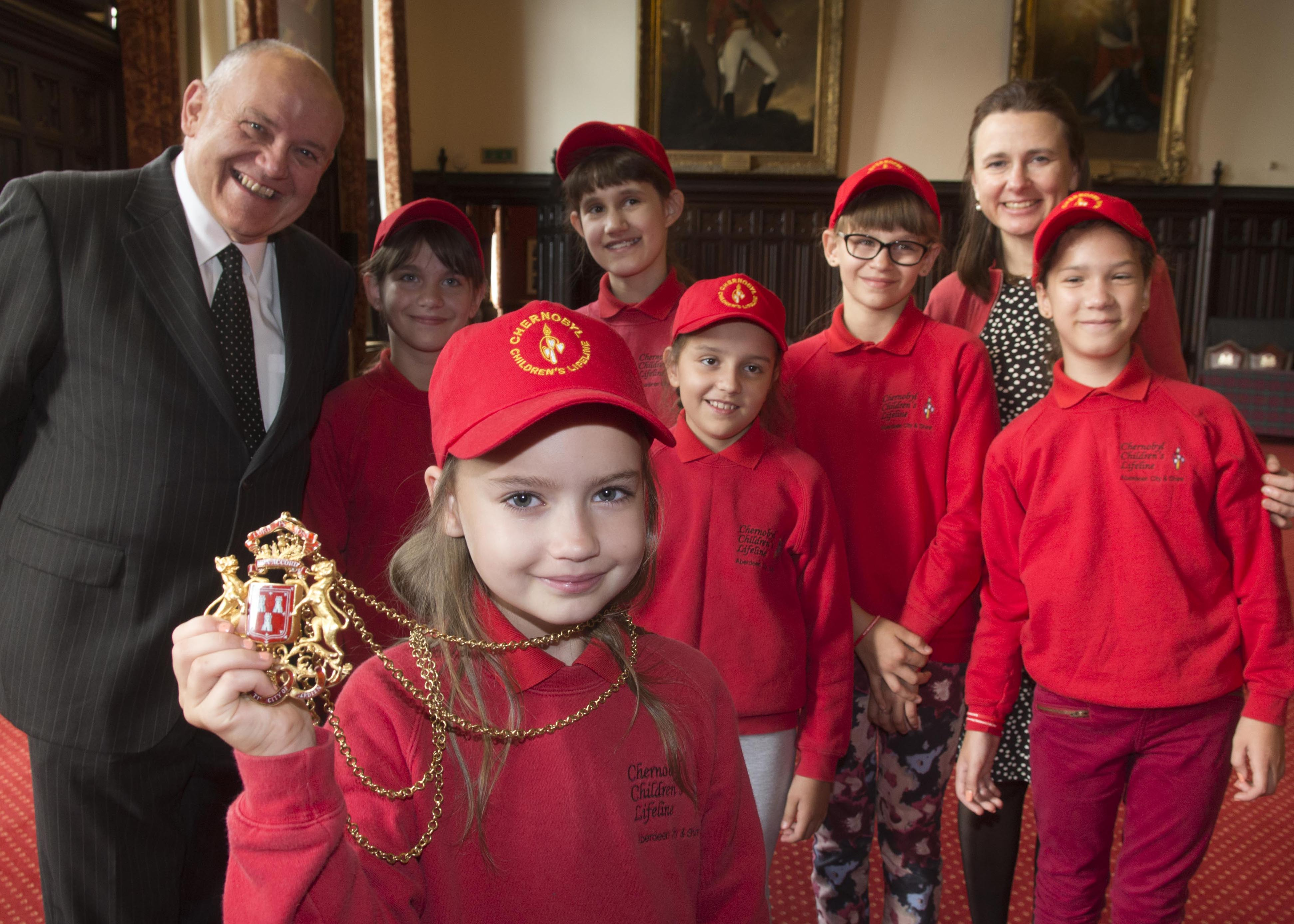Aberdeen Lord Provost Barney Crockett with children from Gomel who visited the Town House during their time in Aberdeen last year