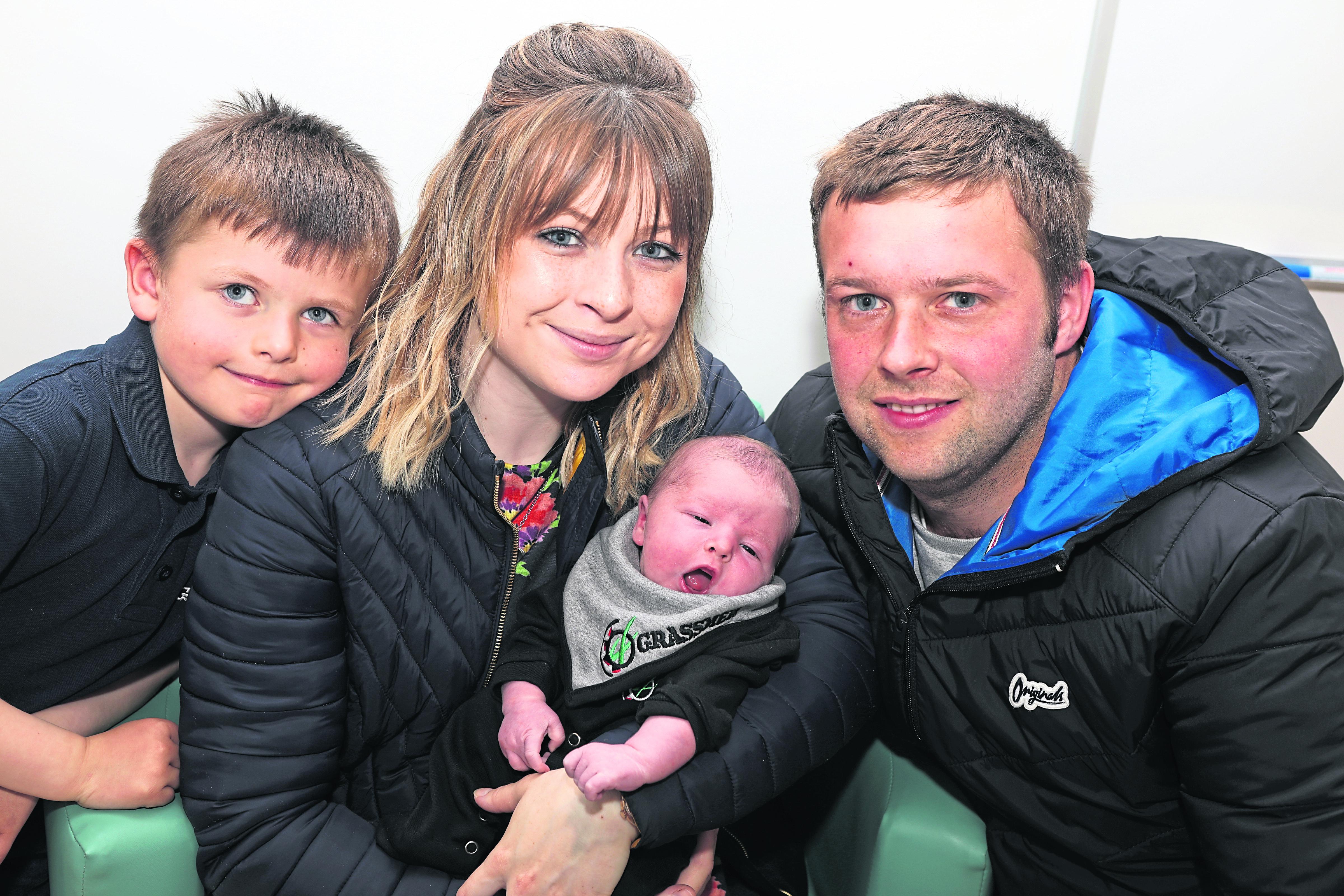 Big brother Luke Clouston aged 5, Mum Kerry Stanger, baby Balfour Savage and Dad Luke Savage.