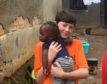 Ellon Academy pupil Bobby Boardman, 14, with a Ugandan child.