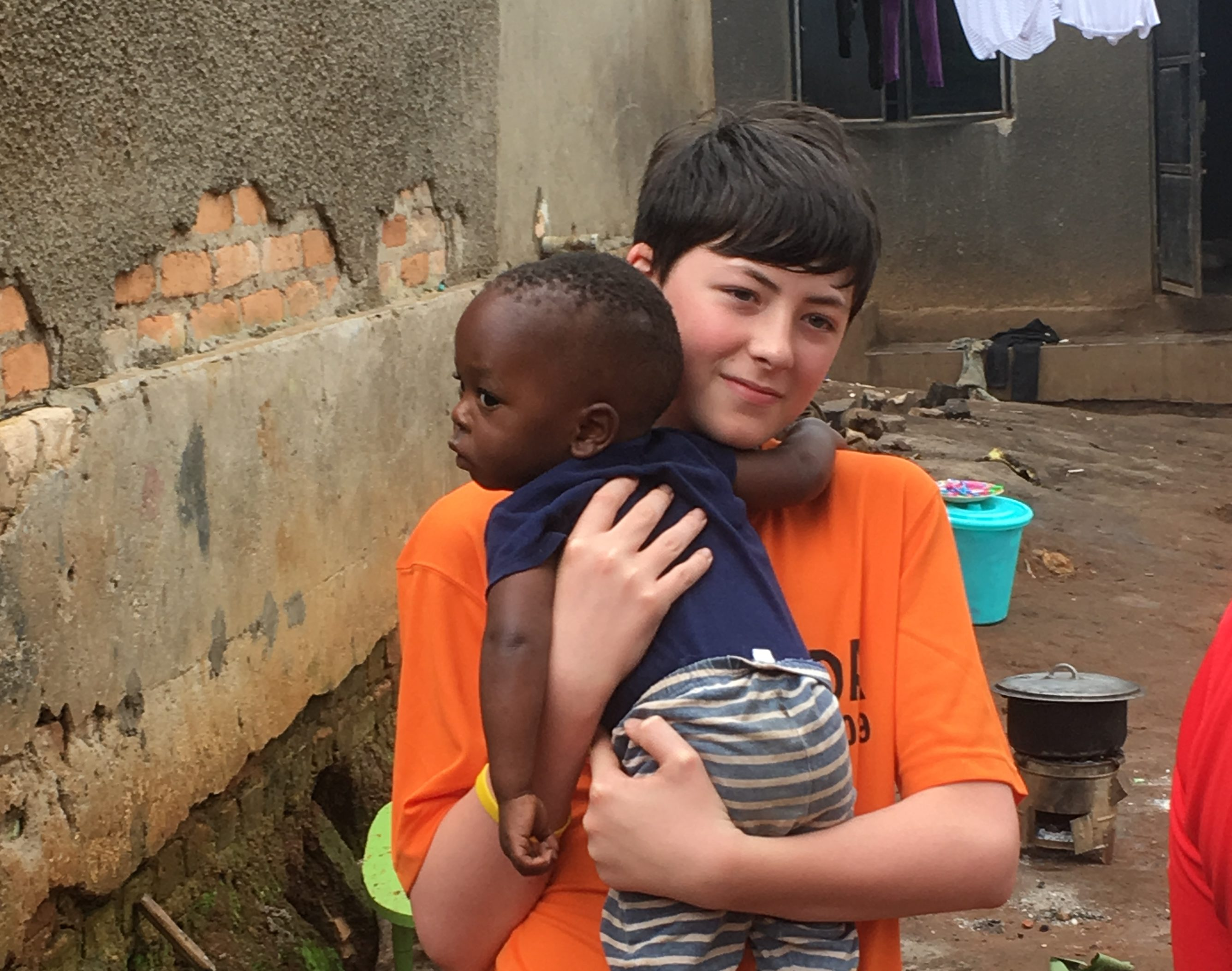 Ellon Academy pupil Bobby Boardman, 14, with a Ugandan child.