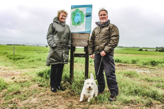 Environment minister Roseanna Cunningham with dog walker Dave Alsson.