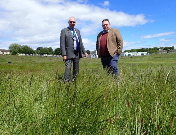 Frank Brown (Left) and Jamie Halcro Johnston MSP (Right) at Brodie Drive, Elgin