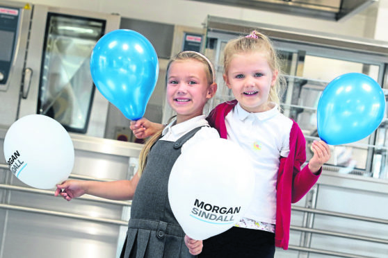 The new extension has been opened at Dalneigh Primary School. The cutting of the ribbon was done by the school's two youngest pupils, Paige Higham (5) and Charlotte Dingwall (6). Picture by Andrew Smith