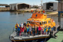 This is the Friends of Chernobyl Children visiting the Lifeboat during their months stay in Moray, Scotland.